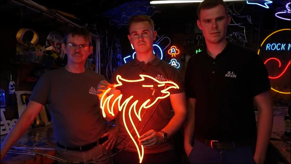 The BL Neon Team after designing the Pheonix Neon Sign for Teelings Whiskey holding their amazing creation
